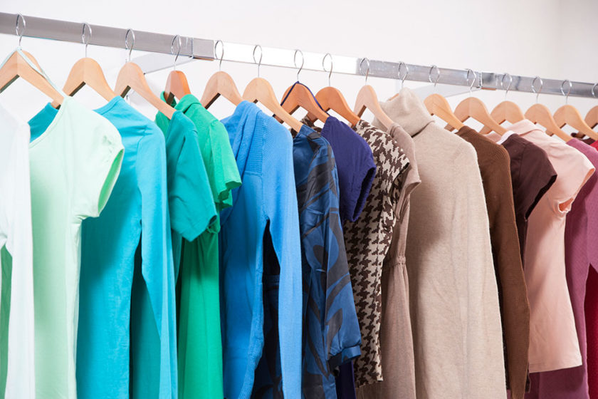 clothes on hangers. Donate to Clothes That Work